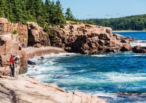 Two Asian Women on rocks in Acadia National Park near Bar Harbor, Maine