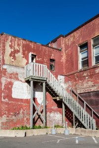 Wood Stairs on Old Red Plaster