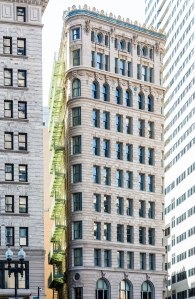 Classic Stone Building with Green Balconies in Boston